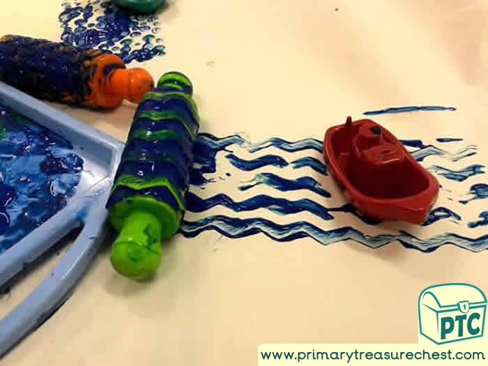 Painting waves for boat Tuff Tray for EYFS Children